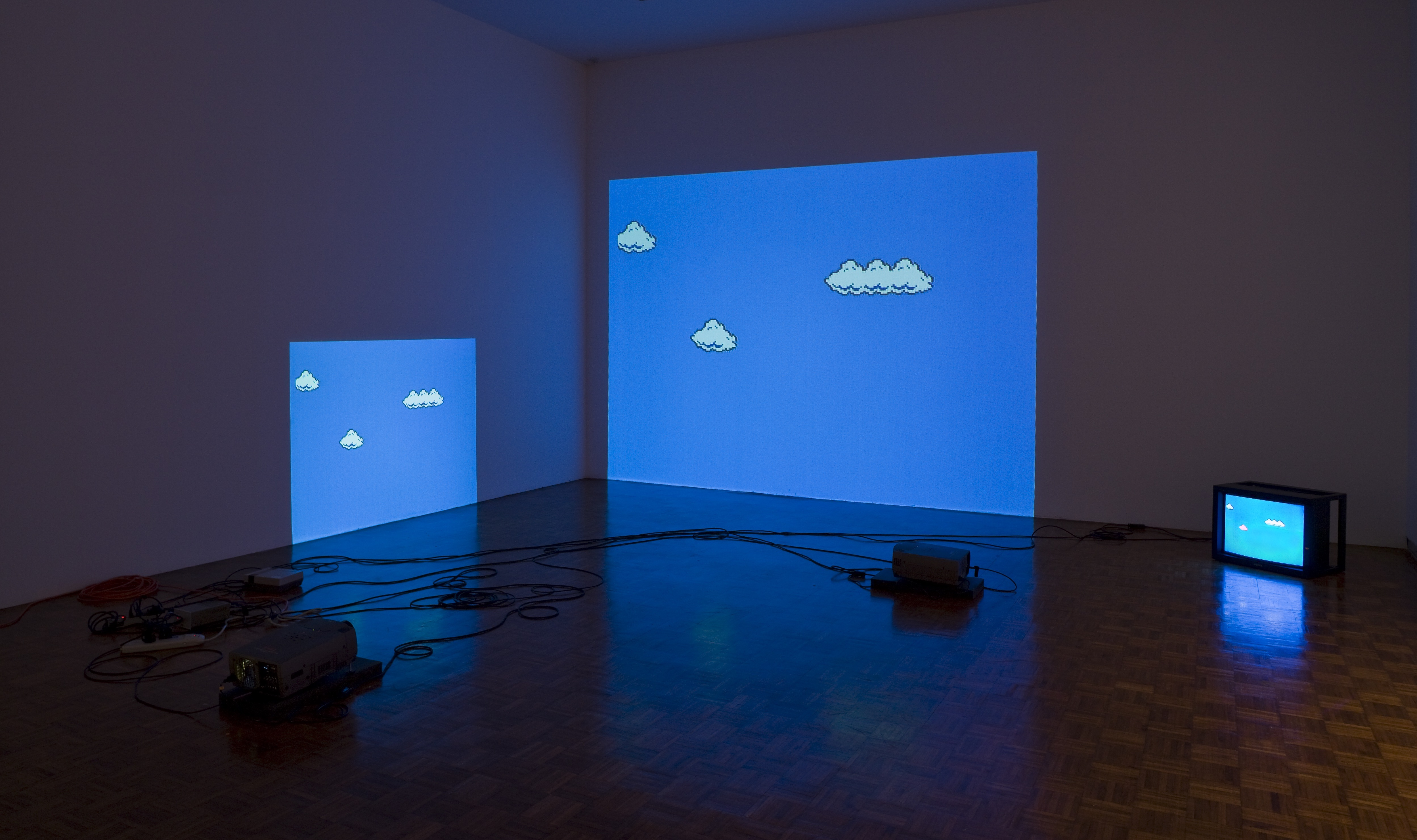 Figure 1. Cory Arcangel. Super Mario Clouds, 2002– . (Installation view, Synthetic, Whitney Museum of American Art, 2009.) Handmade hacked Super Mario Brothers cartridge and Nintendo NES video game system. Edition no. 2/5. Whitney Museum of American Art, New York; purchase with funds from the Painting and Sculpture Committee 2005.10.© Cory Arcangel. Courtesy of Cory Arcangel.