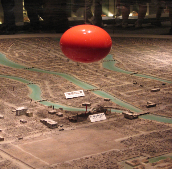 Figure 7. Diorama of Atomic Bomb Blast over Hiroshima, the red sphere representing the bomb blast one second after detonation (Peace Memorial Museum, Hiroshima, Japan). Photo by Steven Feld.